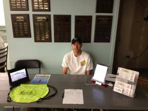 Working the desk, and tracking stats at the Greenwood Tourney
